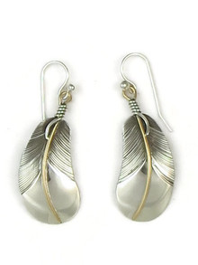 Curved silver feather earrings with 12k gold fill quills by Lena Platero.