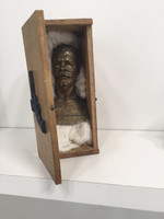 Sandra Ceballos, Untitled, 2014. Sculpture of found objects: Jose Marti in a coffin with a revolver on top.