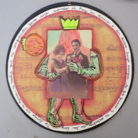 "Brito (Yamilys Brito Jorge) #6136. ""Matrimonio,"" N.D. Mixed media collage on vinyl record. 12 inches diameter"