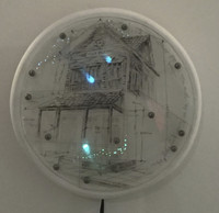 "William Perez #6762. ""Villa Elena, N.D. Mixed media/wood and plexiglass. 12 inches diameter."