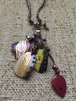 Osvaldo Castilla #416H.  Cigar label charms on necklace.