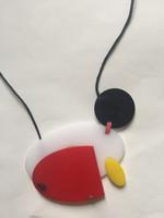 Mondrian-style egg-shaped plastic necklace #423L. Conga design shop, Havana.