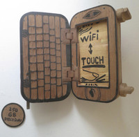 "Abel Barroso (SC)  ""I Phone MP3,"" ND. Mixed media/wood. 7.5 x 4 x 2.5 Inches.  SOLD!"