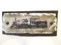 "Dagoberto Driggs Dumois , ""Central Santa Lucia,"" 2014. Mixed media: wood, metal from abandoned sugar mills and railroad ties in and around Holguin. 12"" x 25"" Collection of Sandra Levinson."