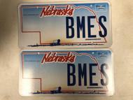 Expired NEBRASKA www . nebraska . gov License Plate BMES PAIR Covered Wagon Ox Prairie