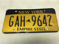 expired, Yellow New York License Plate GAH-9642.