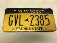 expired, Yellow New York License Plate GVL-2385.