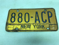 expired, old Yellow New York License Plate 880-ACP.