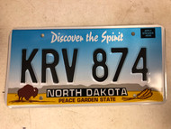 Expired NORTH DAKOTA Peace Garden State License Plate KRV-874 Buffalo Wheat
