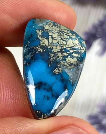 High Grade Ithaca Peak Turquoise cabochon with pyrite