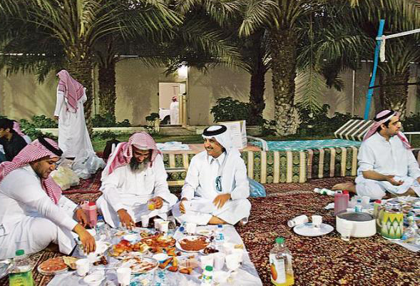 Desert Arabs enjoying a meal