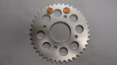 """Rear Drive Sprocket, Pennies are covering the number of teeth of the """"pictured"""" sprocket. Since this is a MULTIPLE sprocket listing we were trying not to confuse anyone."""