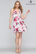 Faviana S10366 is a short chiffon printed dress with a deep v neckline and lace up back.