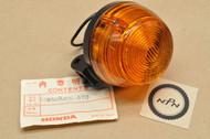 NOS Honda 1980 CM200 T Twin Star Left Rear Blinker Turn Signal 33650-465-670