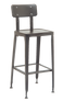 Indoor vintage-style metal bar stool in clear coating finish.