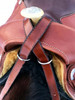Collar straps wrap around pommel and criss-cross on either side of saddle horn.