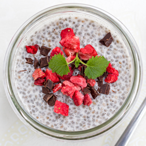 vanilla chia pudding topped with freeze dried strawberries and dark chocolate