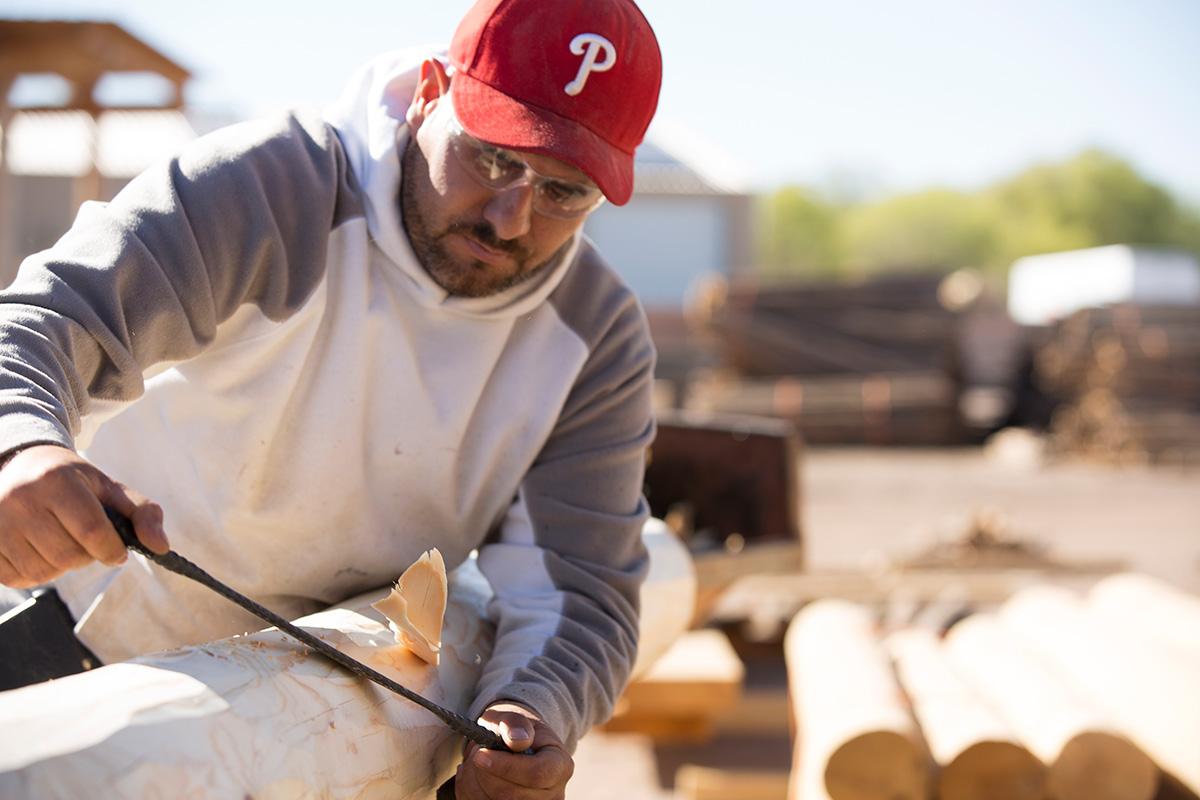Peeling a Pine Log