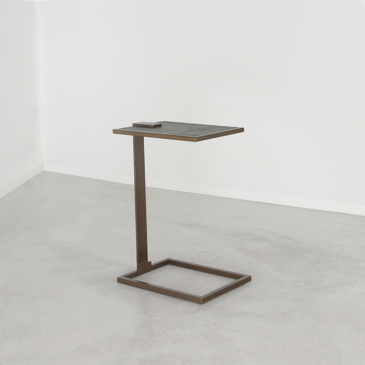 As Shown: Deco Drink Table Size: 10 x 14.5 x 20.5 H inches Material: Steel with Bronze Finish, Leather