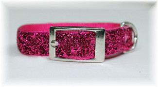 "The newest ""bling"" in dog collars.  Glitter Glamour Dog Collars are made of 5/8 inch wide sturdy top of the line nylon.  Each has a glitter infused ribbon sewn on top for a twist on a regular nylon dog collar.  They  are durable and fashionable and will last a long time. Available in sizes to fit small to large breed dogs and available in gorgeous fashion colors."