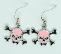 Sk tooth pink skull pendant