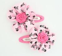 Skull L.pink flower hair clips pair