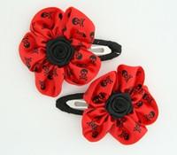 Skull red flower hair clips pair