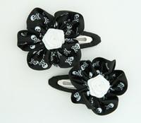 Skull black flower hair clips pair