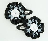 Star black-white flower hair clips pair
