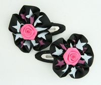 Star black-pink flower hair clips pair