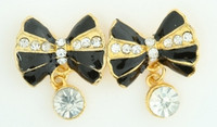 S bow stone black-gold stone stud