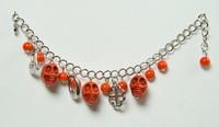 Skull full orange skull bracelet