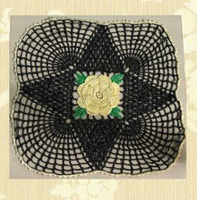 Fancy black metallic web doily
