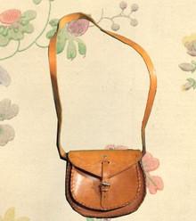 Tooled leather saddle bag
