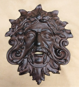 Green man plaque ~ cast iron ~ rust finish