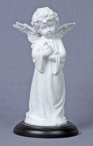 Angel holding a dove, white on wood base