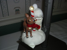 DEPT. 56 -SNOWBABIES RUDOLPH THE RED NOSE REINDEER LIGHT UP FIGURINE-A SURPRISE FOR RUDOLPH