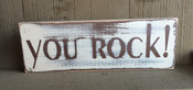 You Rock! Distressed.  Antique white and brown. Size 3.5 x 12.