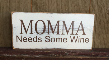 Momma Needs Some Wine. Distressed. Brown and white.  Size 6 x 12.  Comes with rear picture hanger.