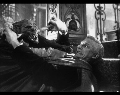 Fright Night's Peter Vincent fights for his life against Jerry Dandridge in his hideous bat form.