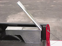 Pork Chop Wheel Well Saddle Truck Toolbox opens up so you can access it from either inside or outside the truck - hinged on the deep end of the box