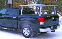 Schooner Aluminum Tonneau Stake Pocket Truck Ladder Rack on a short bed Colorado mounted with a tonneau cover.  This particular truck requires special stake pocket inserts, available at checkout.