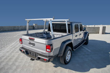 Model 6 - Clipper Ladder Rack Kayak Rack For Jeep Gladiator Trucks sits above cab height and has brushed aluminum crossbars & legs with a bead-blasted stainless steel base.