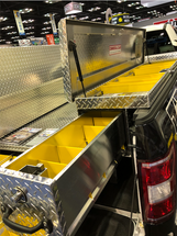 Brute LosiderSafe Side Mount Truck Toolbox mounted on the passenger side of the truck bed showing the removable compartment and drawer dividers. This toolbox is also available in textured black powder coat. BedSafe and crossbox toolboxes shown in the photo are not included.