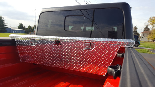 Diamond Plate Aluminum Jeep Gladiator Narrow Low Profile Crossover Toolbox is available in brute aluminum or black powder coat finishes.