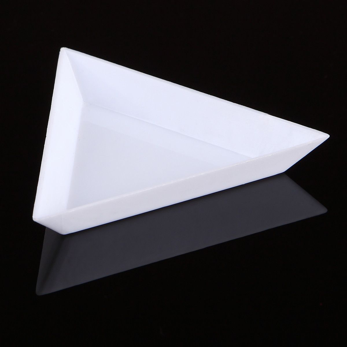 Triangle spill tray for holding glitter, rhinestones and other nail art supplies. Available at www.lanternandwren.com.