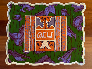 """One-of-a-kind challah covers crafted by the Tiferet Israel community in Sefwi Wiawso, Ghana. They are truly beautiful crafts, with embroidery and pieced African fabrics surrounding the Hebrew word """"Shabbat"""" in the center. As no two are exactly alike, bulk orders will be comprised of assorted colors and patterns.                                                                                                          Proceeds from the sale of the challah covers benefit the Jewish community of Ghana."""