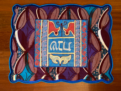 """One-of-a-kind challah covers crafted by the Tiferet Israel community in Sefwi Wiawso, Ghana. They are truly beautiful crafts, with embroidery and pieced African fabrics surrounding the Hebrew word """"Shabbat"""" in the center. As no two are exactly alike, bulk orders will be comprised of assorted colors and patterns.                                                                                                       Proceeds from the sale of the challah covers benefit the Jewish community of Ghana.."""