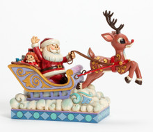 Rudolph Pulling Santa in Sleigh
