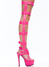 Make a statement at a rave, carnival, festival, or samba competition with these stylish, sexy, chic boots! Featuring cutout detailing, a sexy platform, Velcro straps, and a cushioned foot bed. Approximately 6.5 in heel, 2.5 in platform.